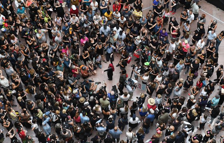 Demonstrators gather Thursday inside the Hart Senate Office Building for a rally against Brett Kavanaugh's Supreme Court nomi