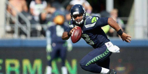 SEATTLE, WA - SEPTEMBER 21:  Quarterback Russell Wilson #3 of the Seattle Seahawks scrambles against the Denver Broncos at Ce