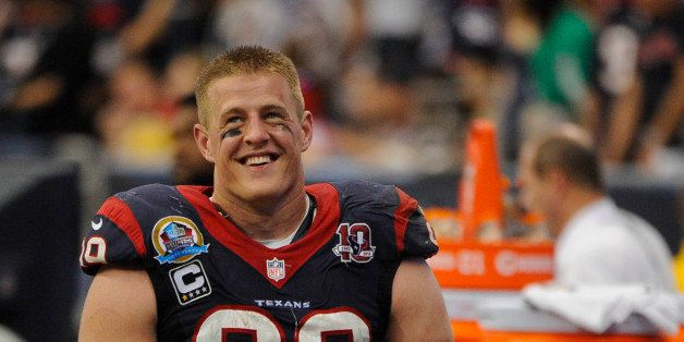 FILE - In this Dec. 16, 2012 file photo, Houston Texans' J.J. Watt stands on the sidelines in the fourth quarter of an NFL fo