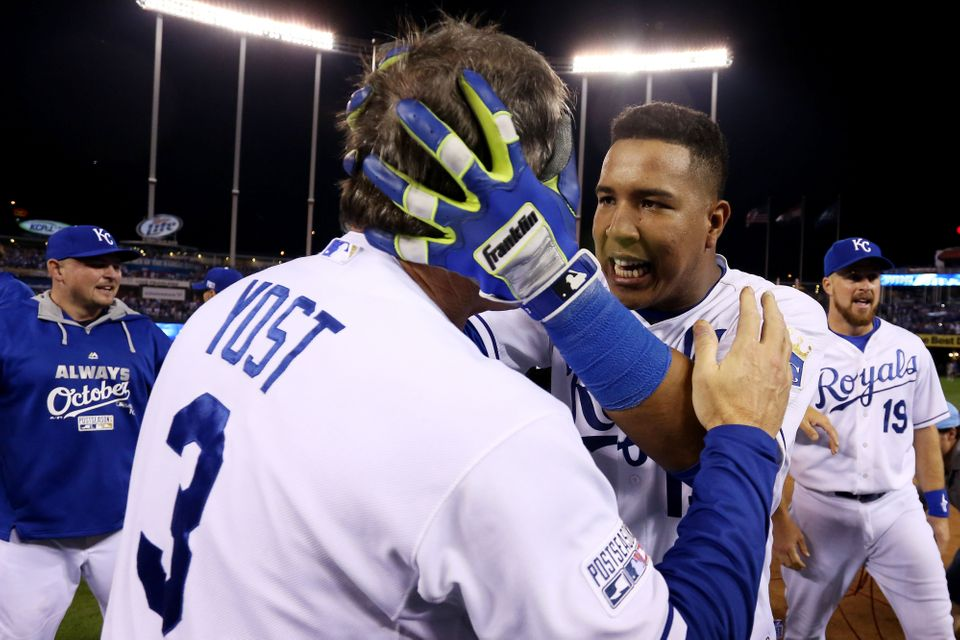 KANSAS CITY, MO - SEPTEMBER 30:  Manager Ned Yost #3 celebrates with Salvador Perez #13 of the Kansas City Royals after they