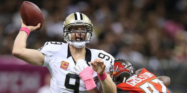 NEW ORLEANS, LA - OCTOBER 05:  Drew Brees #9 of the New Orleans Saints throws a pass against the Tampa Bay Buccaneers  at the
