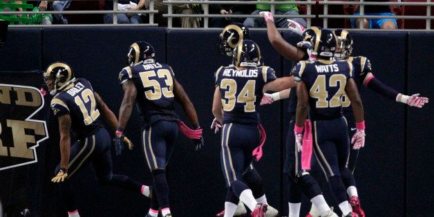 St. Louis Rams' Stedman Bailey, left, is congratulated by teammates after running a punt back 90 yards for a touchdown during