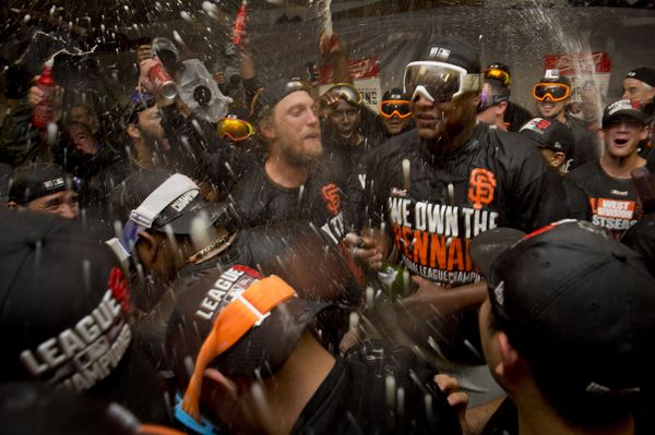 After clinching the National League West title in 2010, Giants players Matt Cain, Barry Zito, Buster Posey, Aubrey Huff, Fred