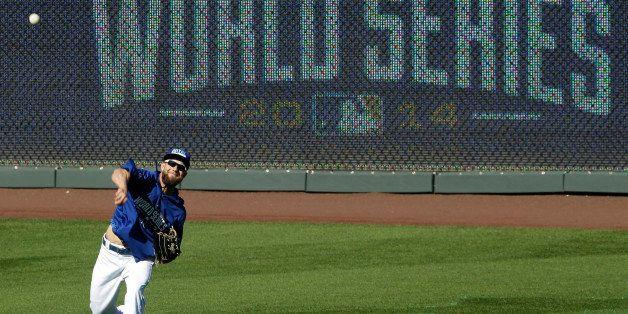 Kansas City Royals' Alex Gordon throws during baseball practice Monday, Oct. 20, 2014, in Kansas City, Mo. The Royals will ho