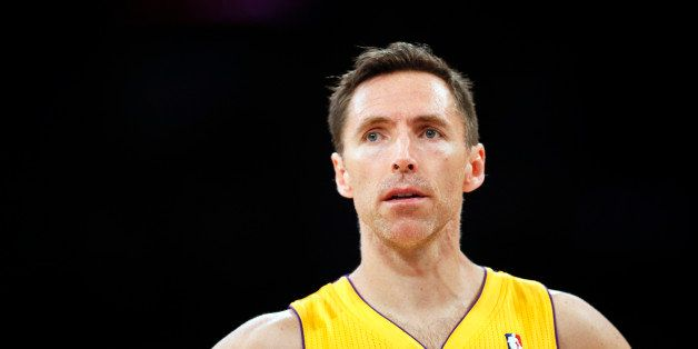 FILE - In this April 1, 2014, file photo, Los Angeles Lakers guard Steve Nash stands on the court during the first half of an