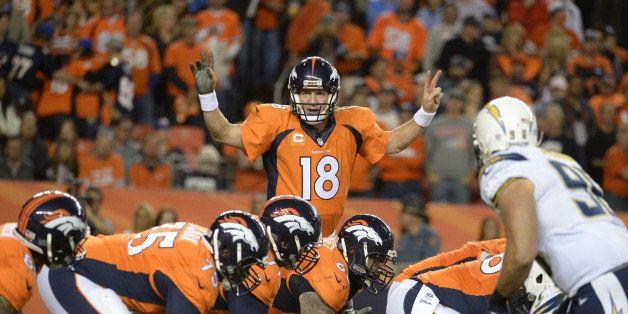 DENVER, CO - OCTOBER 23: Peyton Manning (18) of the Denver Broncos runs the offense during the fourth quarter. The Denver Bro