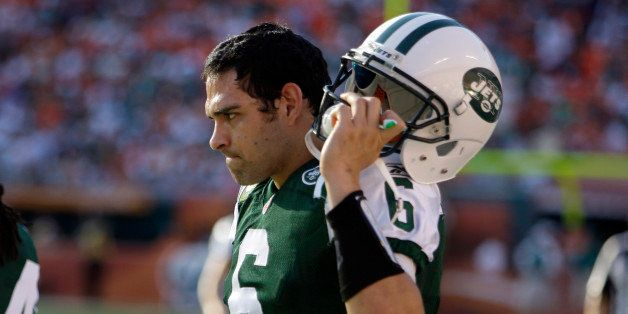 New York Jets quarterback Mark Sanchez (6) stands on the sideline during the final minutes of an NFL football game against th