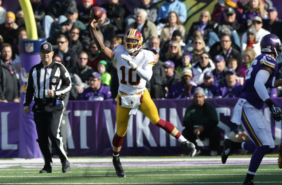 Washington Redskins quarterback Robert Griffin III throws a pass during the first half of an NFL football game against the Mi