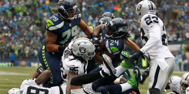 SEATTLE, WA - NOVEMBER 02: Running back Marshawn Lynch #24 of the Seattle Seahawks bulls his way into the end zone for a touc
