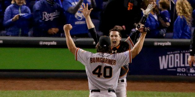 San Francisco Giants starting pitcher Madison Bumgarner, left, and catcher Buster Posey celebrate 3-2 win against the Kansas