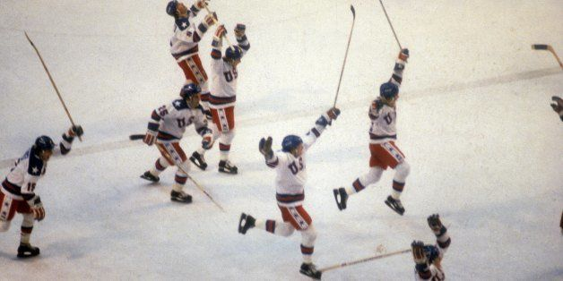 LAKE PLACID, NY - FEBRUARY 22:  United States Olympic Hockey players jump with jubilation after beating the Soviet Union hock