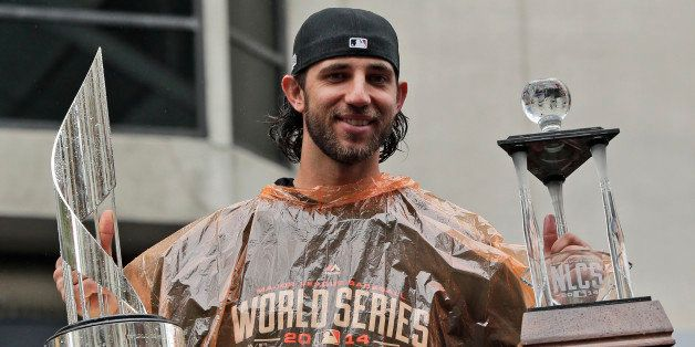San Francisco Giants baseball player and World Series MVP Madison Bumgarner holds the MVP trophies during the victory parade
