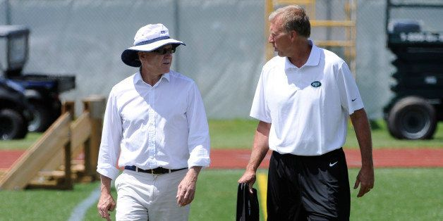 New York Jets owner Woody Johnson, left, talks with general manager John Idzik at their NFL football training camp Friday, Ju