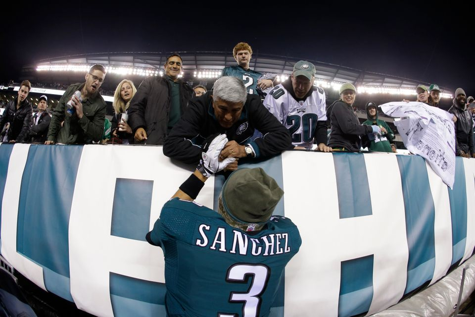 Philadelphia Eagles' Mark Sanchez meets with spectators after an NFL football game against the Carolina Panthers, Monday, Nov