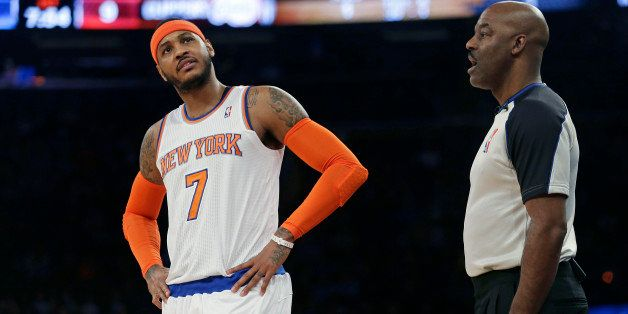 New York Knicks' Carmelo Anthony (7) argues a call with referee Haywoode Workman during the first half of an NBA basketball g