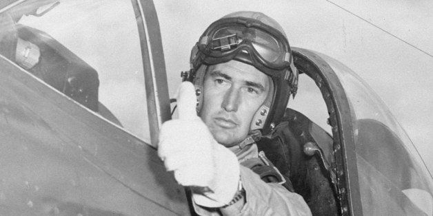 Ted Williams flashes the pilot's traditional thumb-up sign of  okay  to his mechanic while taking his attack aviation refresh