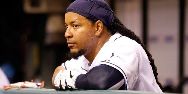 ST. PETERSBURG, FL - APRIL 05:  Designated hitter Manny Ramirez #24 of the Tampa Bay Rays watches his team from the dugout ag