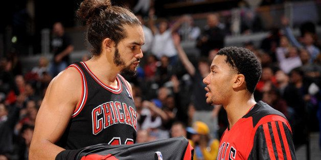 DENVER, CO - NOVEMBER 21:  Joakim Noah #13 and Derrick Rose #1 of the Chicago Bulls talk during the game against the Denver N