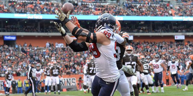 CLEVELAND, OH - NOVEMBER 16:  J.J. Watt #99 of the Houston Texans makes a touchdown catch in front of Chris Kirksey #58 of th