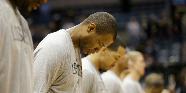Brooklyn Nets' Jason Collins, second from left, during the national anthem before an NBA basketball game against the Milwauke