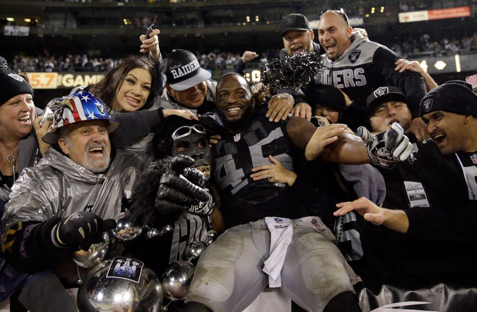 OAKLAND, CA - NOVEMBER 20:  Marcel Reece #45 of the Oakland Raiders celebrates with fans in the Black Hole after the Raiders
