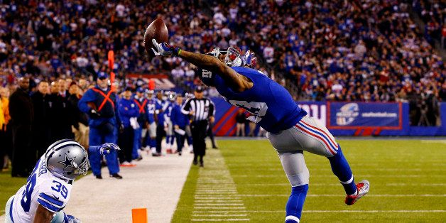 EAST RUTHERFORD, NJ - NOVEMBER 23:  Odell Beckham #13 of the New York Giants scores a touchdown in the second quarter against
