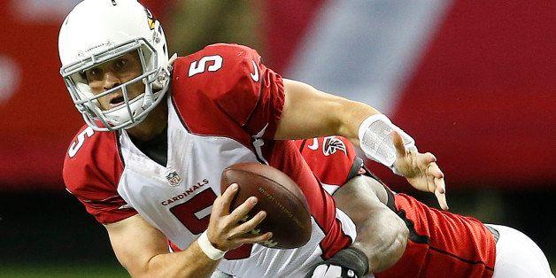 Atlanta Falcons defensive end Jonathan Babineaux hits Arizona Cardinals quarterback Drew Stanton (5) during the first half of