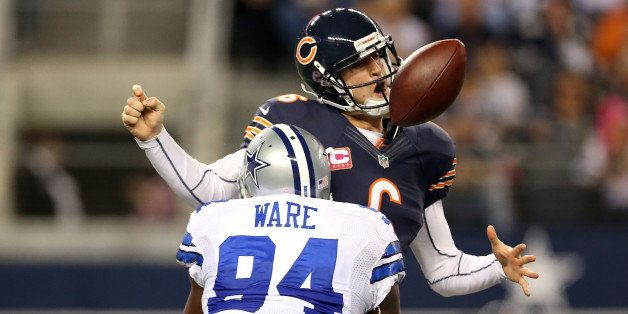ARLINGTON, TX - OCTOBER 01:  Jay Cutler #6 of the Chicago Bears fumbles the ball as he is sacked by DeMarcus Ware #94 of the