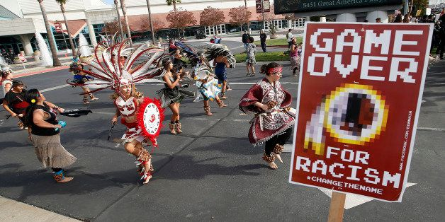 A group protests the Washington Redskins name across from Levi's Stadium before an NFL football game between the Redskins and