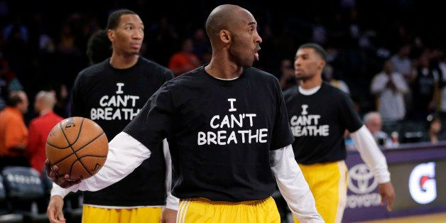 Los Angeles Lakers' Kobe Bryant, center, and his teammates warm up before an NBA basketball game against the Sacramento Kings