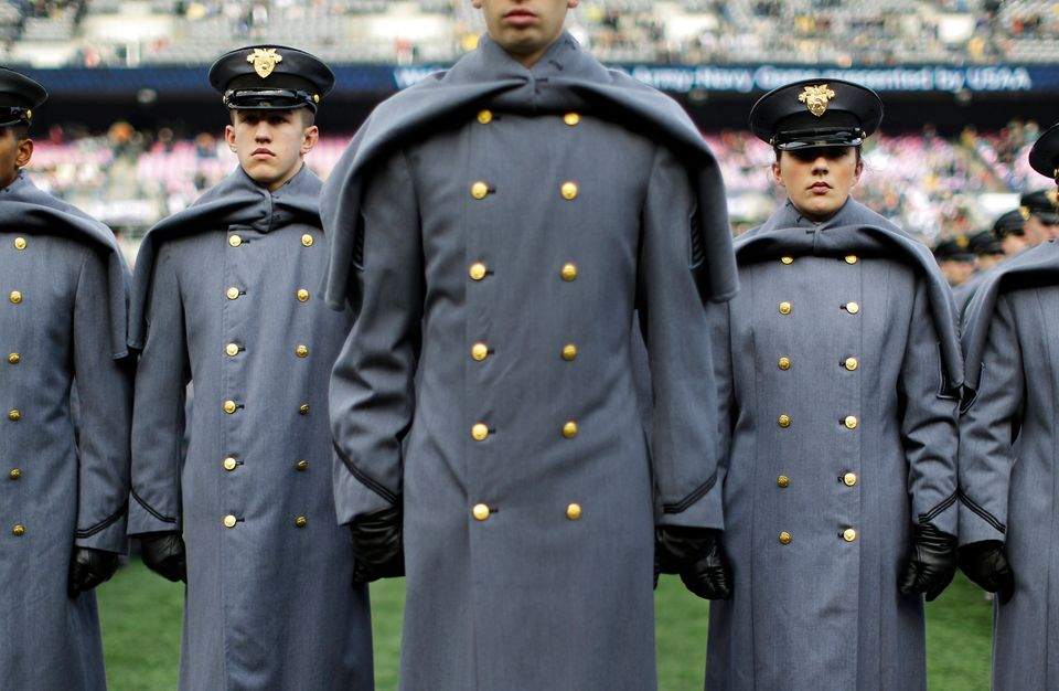 Army Cadets stand in formation on the field before the Army-Navy NCAA college football game, Saturday, Dec. 13, 2014, in Balt