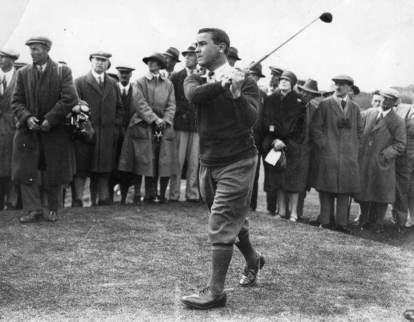 1935:  Golfer Gene Sarazen of the USA taking a shot, surrounded by spectators.  (Photo by Central Press/Getty Images)
