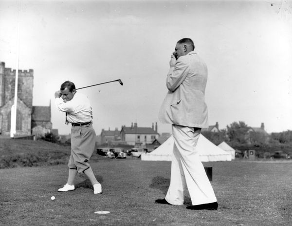 June 1936:  US golfer Gene Sarazen being photographed by golfer James Ferrier during the British Open Championship at Hoylake
