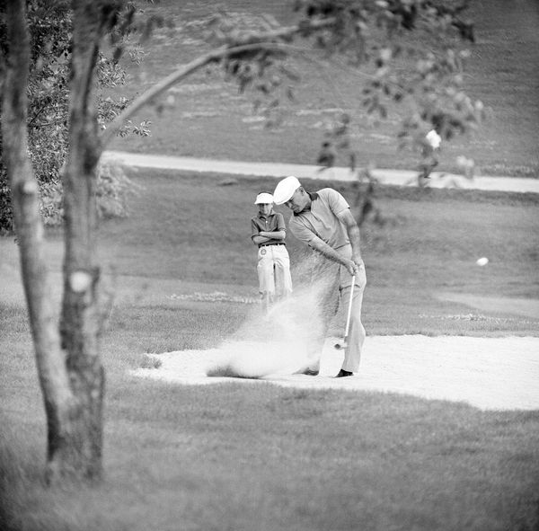Ben Hogan, warming up for another try at winning his fifth U.S. Open championship, hits a No. 4 wood from a fairway trap on D