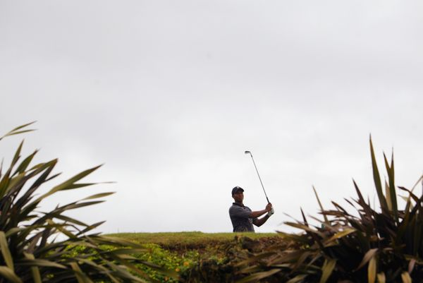 KAUAI, HI - NOVEMBER 27:   Masters and US Open Champion Tiger Woods hits his first shot on the 17th hole during the final rou