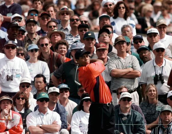 Tiger Woods tees off on the fifth hole during final round Masters play at the Augusta National Golf Club in Augusta, Ga., Sun