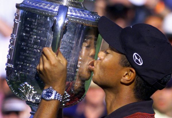 Tiger Woods kisses the Wanamaker trophy after winning the 81st PGA Championship at the Medinah Country Club in Medinah, Ill.,