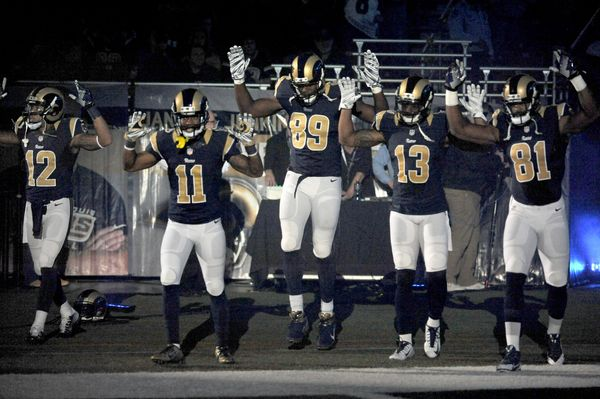 St. Louis Rams players Stedman Bailey (12), Tavon Austin (11), Jared Cook, (89) Chris Givens (13) and Kenny Britt (81) raised