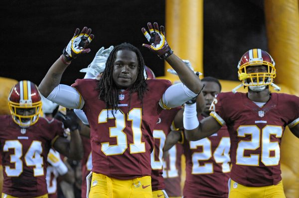 A group of Washington defensive players, including safety Brandon Meriweather, took the field for a preseason game with their