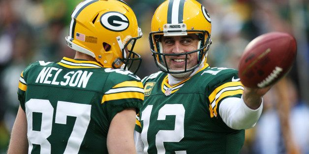 GREEN BAY, WI - DECEMBER 28:  Aaron Rodgers #12 of the Green Bay Packers reacts in the first quarter against the Detroit Lion