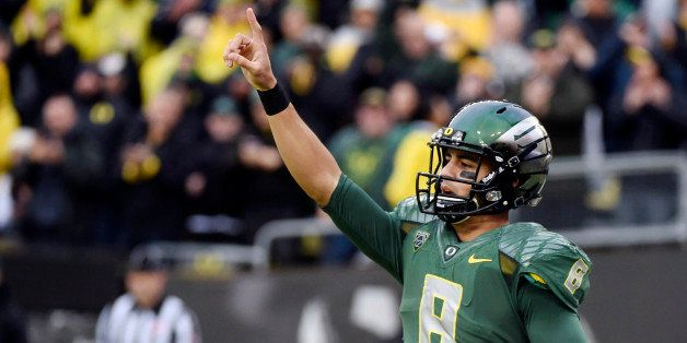 FILE - In this Nov. 22, 2014, file photo, Oregon quarterback Marcus Mariota (8) celebrates after scoring a touchdown during t