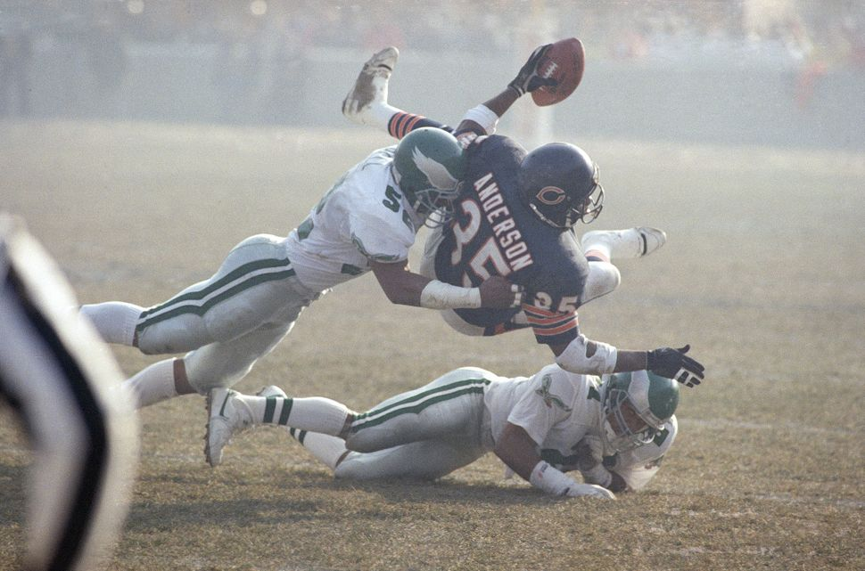 Chicago Bears running back Neal Anderson (35) is tackled by Philadelphia Eagles linebacker Todd Bell, left, and cornerback Er