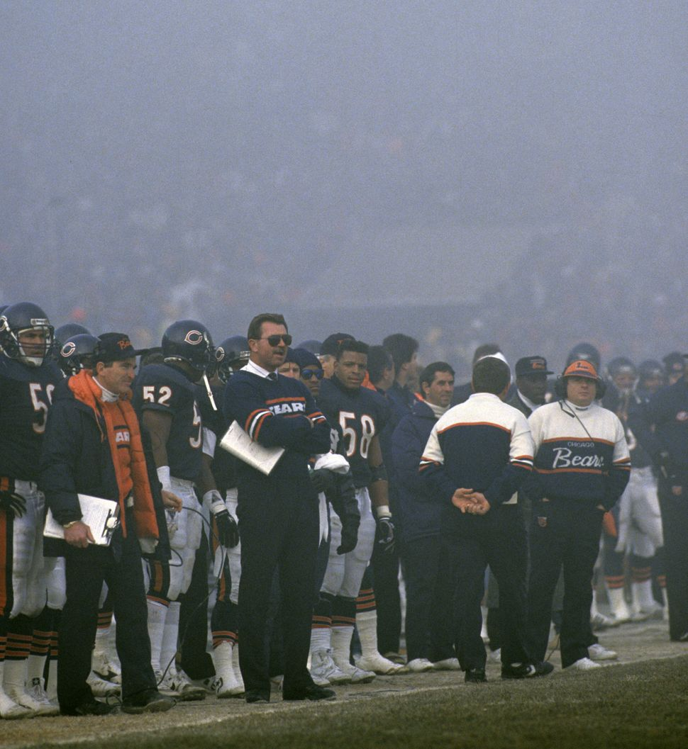Chicago Bears head coach Mike Ditka (with sunglasses) watches the fog roll in during the NFC Divisional Playoff, a 20-12 vict
