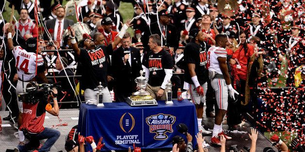 NEW ORLEANS, LA - JANUARY 01:  Head coach Urban Meyer and the Ohio State Buckeyes celebrate with the trophy after defeating t