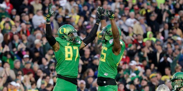 Oregon wide receiver Darren Carrington, left, celebrates his touchdown with tight end Pharaoh Brown during the second half of