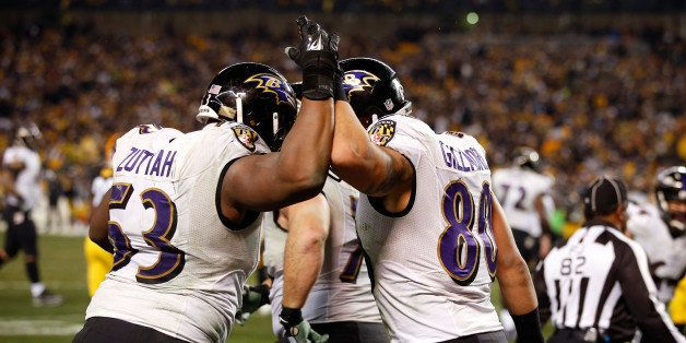 PITTSBURGH, PA - JANUARY 03:  Crockett Gillmore #80 celebrates a fourth quarter touchdown with Jeremy Zuttah #53 of the Balti