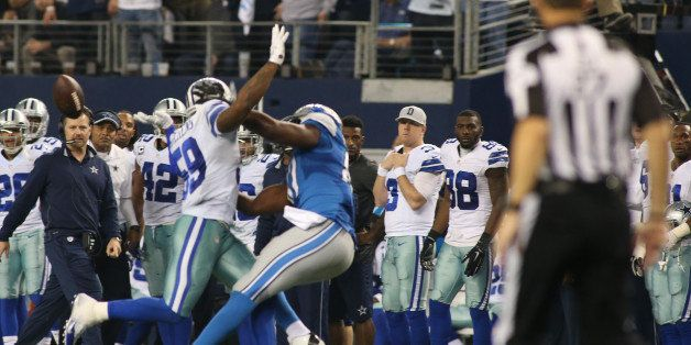 Dallas Cowboys outside linebacker Anthony Hitchens (59) gets hit in the back by a pass to Detroit Lions tight end Brandon Pet