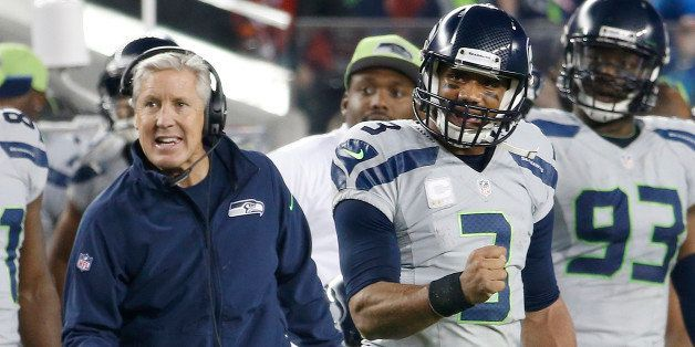 Seattle Seahawks head coach Pete Carroll, left, and quarterback Russell Wilson (3) celebrate during the fourth quarter of an