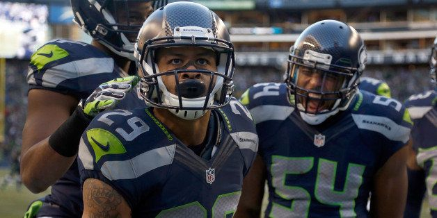 SEATTLE, WA - DECEMBER 14: Free safety Earl Thomas #29 of the Seattle Seahawks celebrates with middle linebacker Bobby Wagner