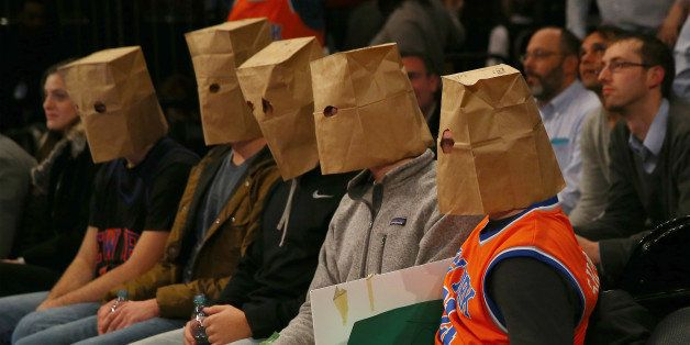 NEW YORK, NY - JANUARY 08:  New York Knicks fans wear bags over their heads and react as the New York Knicks lose at Madison